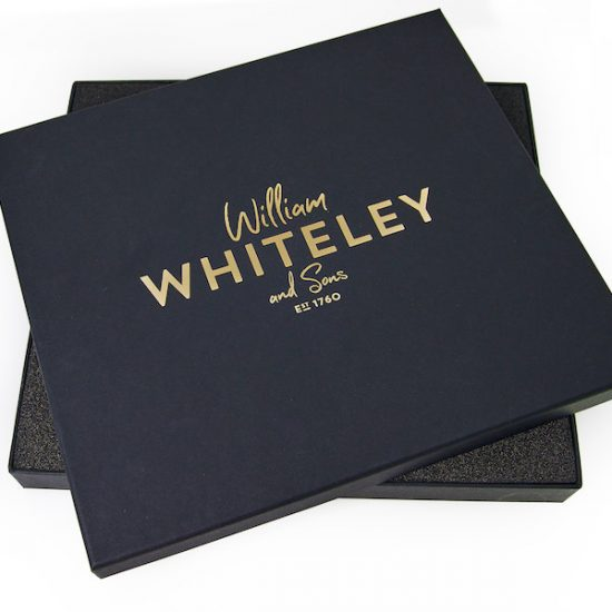 Elegant black gift box with gold lettering