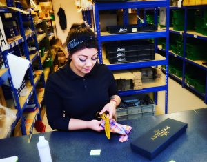 Jade packing an EXO gold in the warehouse