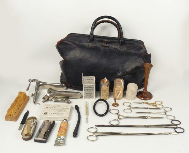 Specula, umbilical tape, gauze, stethoscope, pessaries, scissors, forceps, irrigator, syringe, OTC preparation, thermometer, satchel, brush, nail file.  2012.0128.01, 2012.0128.02, 2012.0128.04, 2012.0128.05, 2012.0128.06, 2012.0128.07, 2012.0128.08, 2012.0128.17, 2012.0128.18, 2012.0128.19, 2012.0128.20, 2012.0128.21, 2012.0128.22, 2012.0128.23, 2012.0128.24, 2012.0128.25, 2012.0128.26, 2012.0128.27, 2012.0128.28, 2012.0128.29, 2012.0128.30, 2012.0128.31, 2012.3061.01, 2012.3061.02.